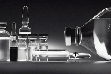 black and white image of lab bottles